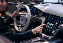 A woman touches the display inside a Volvo car during the media day ahead of the 84th Geneva Motor Show at the Palexpo Arena in Geneva