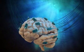 Human brain connected to cables and computer chips