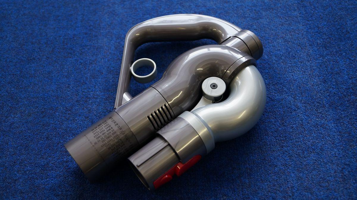 Ручка с курком регулировки мощности всасывания с подвижным соединителем штанги и шланга